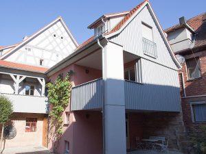 Anbau und Sanierung eines denkmalgeschützten Wohn- und Geschäftshauses